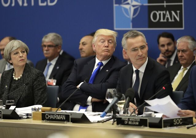 British Prime Minister Theresa May, U.S. President Donald Trump and NATO Secretary General Jens Stoltenberg listen to Belgian Prime Minister Charles Michel as he speaks during a working dinner meeting at the NATO headquarters during a NATO summit of heads of state and government in Brussels on Thursday, May 25, 2017