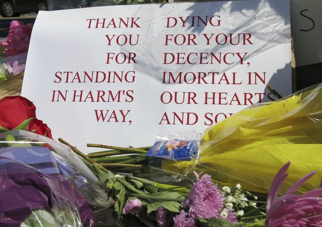 a memorial outside the transit center in Portland, Ore. on Saturday, May 27, 2017, for two bystanders who were stabbed to death Friday, while trying to stop a man who was yelling anti-Muslim slurs and acting aggressively toward two young women