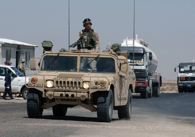 A convoy of fuel tanker trucks escorted by a US Army vehicle enter Kuwait at the military border post of Abdaly in the Kuwait-Iraq frontier in this file photo taken January 2006
