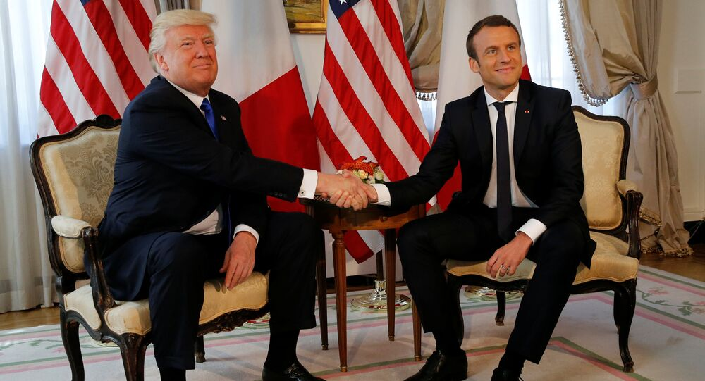 U.S. President Donald Trump (L) and French President Emmanuel Macron shake hands before a lunch ahead of a NATO Summit in Brussels, Belgium, May 25, 2017