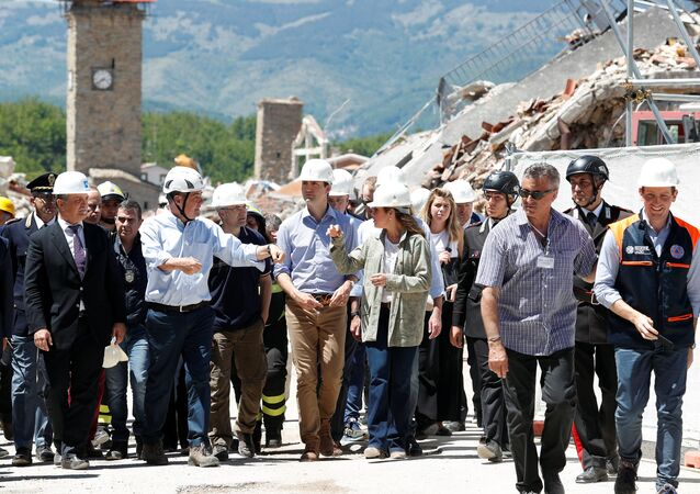 Canada's Prime Minster Justin Trudeau and his wife Sophie Gregoire Trudeau listen to the President of the Province of Rome Nicola Zingaretti during his visit to the town of Amatrice, which was levelled after an earthquake last year, in central Italy, May 28, 2017