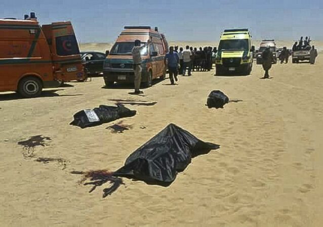 This image released by the Minya governorate media office shows bodies of victims killed when gunmen stormed a bus in Minya, Egypt, Friday, May 26, 2017. Egyptian officials say dozens of people were killed and wounded in an attack by masked militants on a bus carrying Coptic Christians, including children, south of Cairo