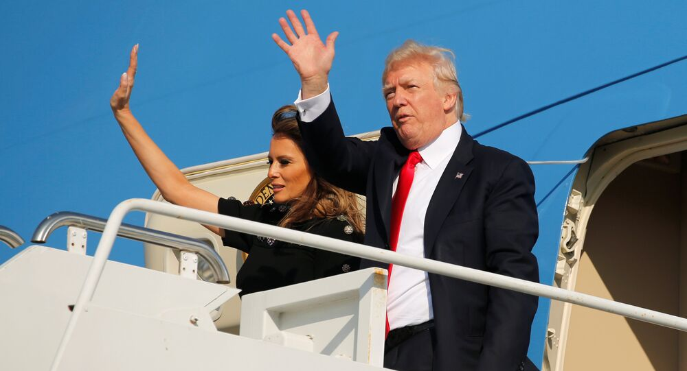 U.S. President Donald Trump and first lady Melania Trump wave outside Air Force One before returning to Washington D.C. at Sigonella Air Force Base in Sigonella, Sicily, Italy, May 27, 2017
