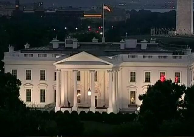 Strange red lights flash from within the white house