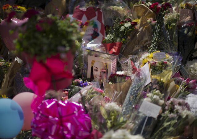 A portrait of Eilidh MacLeod, 14, who has been named as one of those who died in Monday's Manchester bombing, is seen at St Ann's Square in central Manchester, England, Friday, May 26 2017.