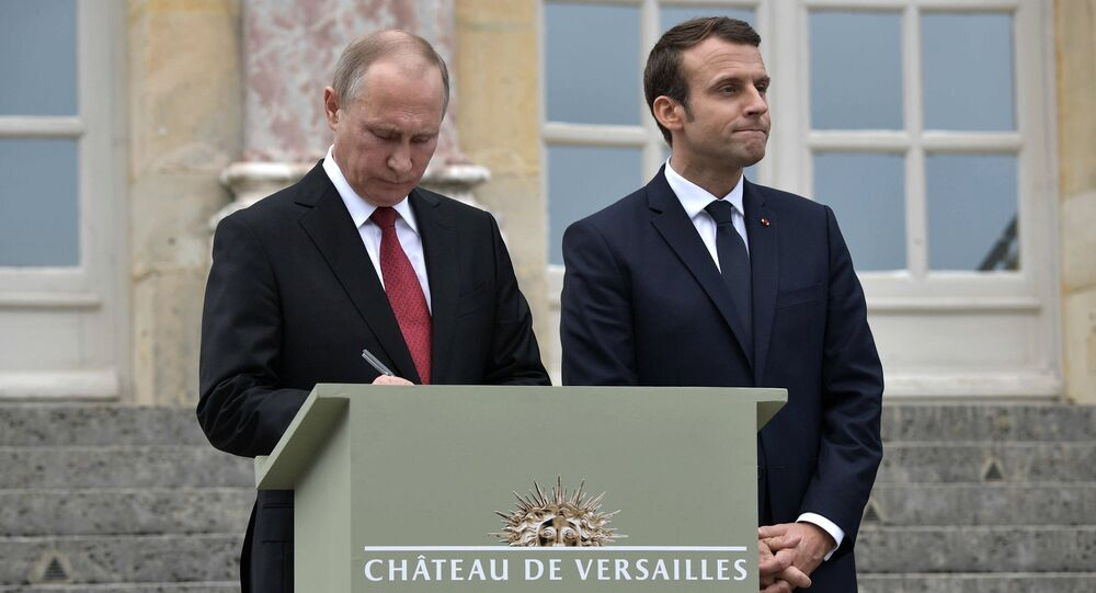 May 29, 2017. Russian President Vladimir Putin leaves an entry in the Honored Visitor Book of the National Museum of Versailles and Trianon, Versailles. Right: French President Emmanuel Macron