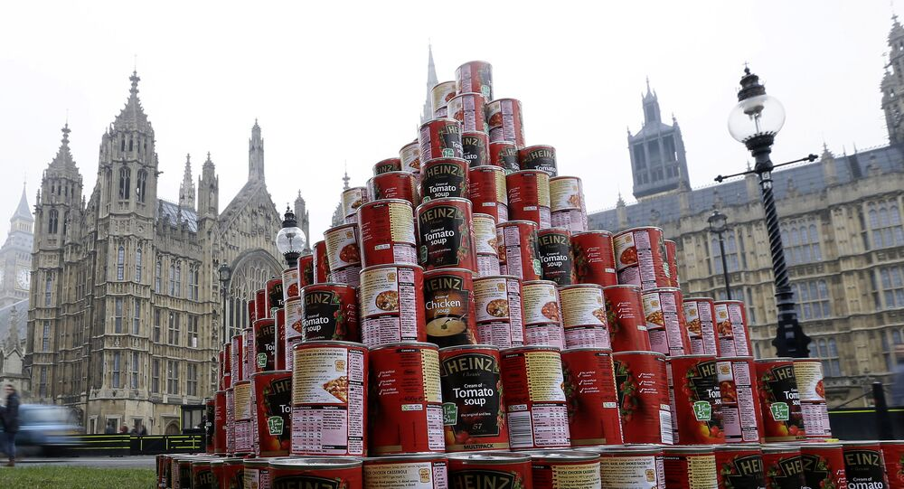 A pyramid of 468 cans of soup during a media event outside the Palace of Westminster to highlight food bank dependency.