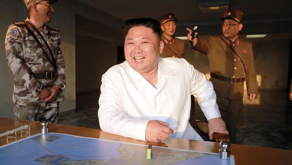 North Korean leader Kim Jong Un reacts during a ballistic rocket test-fire through a precision control guidance system in this undated photo released by North Korea's Korean Central News Agency (KCNA) May 30, 2017 - Sputnik International