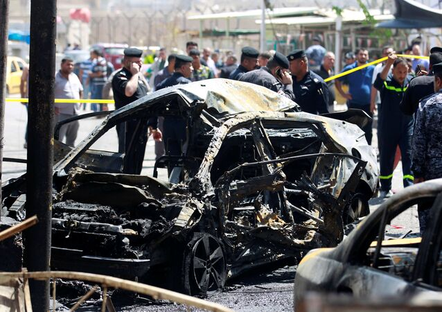 A wreckage of a car is seen at the site of car bomb attack near a government office in Karkh district in Baghdad, Iraq May 30, 2017
