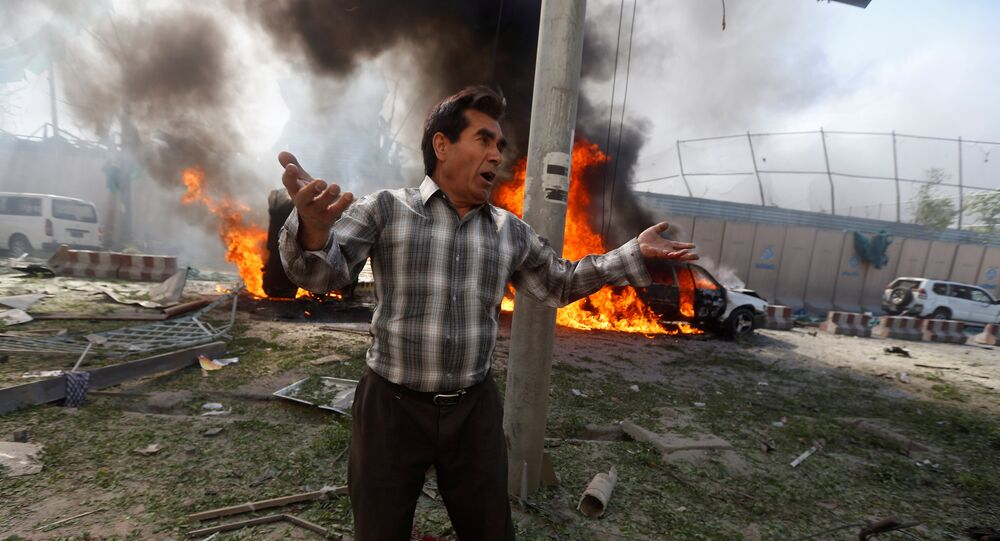 An Afghan man reacts at the site of a blast in Kabul, Afghanistan May 31, 2017.