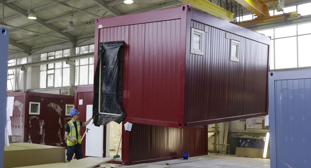 Worker moves a modular container
