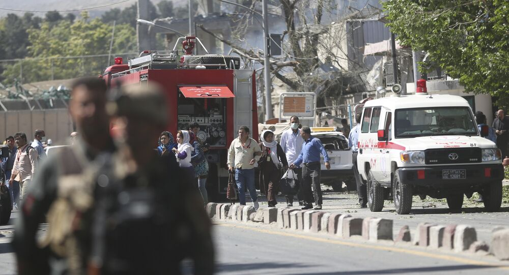 Security forces and medics work the site of a suicide attack in Kabul, Afghanistan