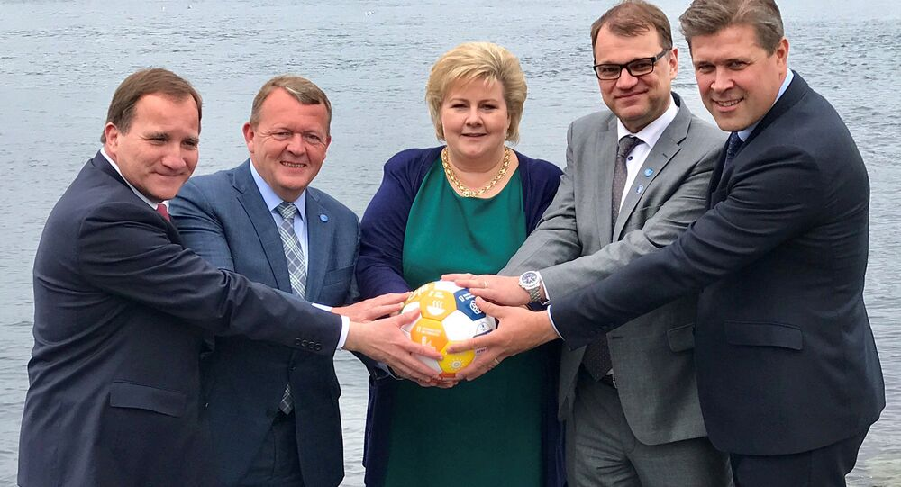 Sweden's Prime Minister Stefan Lofven (L-R), with his counterparts Lars Lokke Rasmussen of Denmark, Erna Solberg of Norway, Juha Sipila of Finland and Bjarni Benediktsson of Iceland hold a soccer ball during their meeting in Bergen, Norway May 29, 2017. Picture taken May 29, 2017.