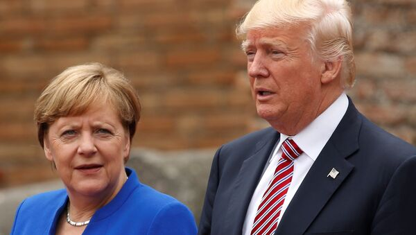 US President Donald Trump and German Chancellor Angela Merkel pose during a family photo at the Greek Theatee during a G7 summit in Taormina, Sicily, Italy, May 26, 2017. - Sputnik International