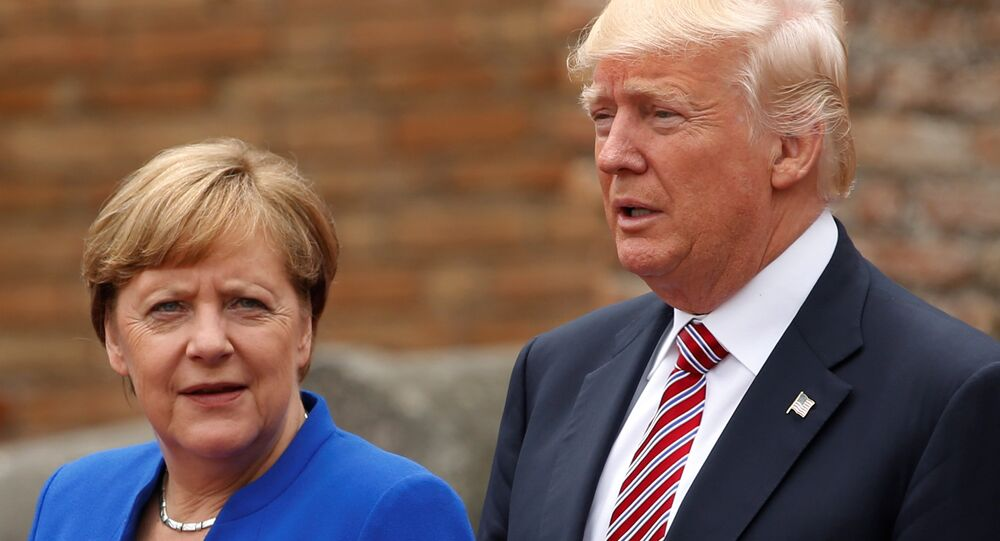 US President Donald Trump and German Chancellor Angela Merkel pose during a family photo at the Greek Theatee during a G7 summit in Taormina, Sicily, Italy, May 26, 2017.