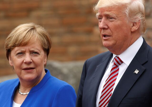 US President Donald Trump and German Chancellor Angela Merkel pose during a group photo at the G7 summit in Taormina, Sicily, Italy, 26 May  2017.