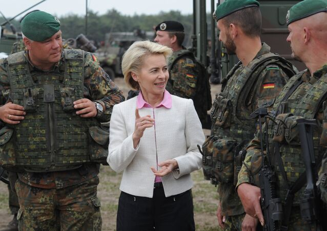 German Defense Minister Ursula von der Leyen speaks with German soldiers after the NATO Noble Jump exercise on a training range near Swietoszow Zagan, Poland, Thursday, June 18, 2015.