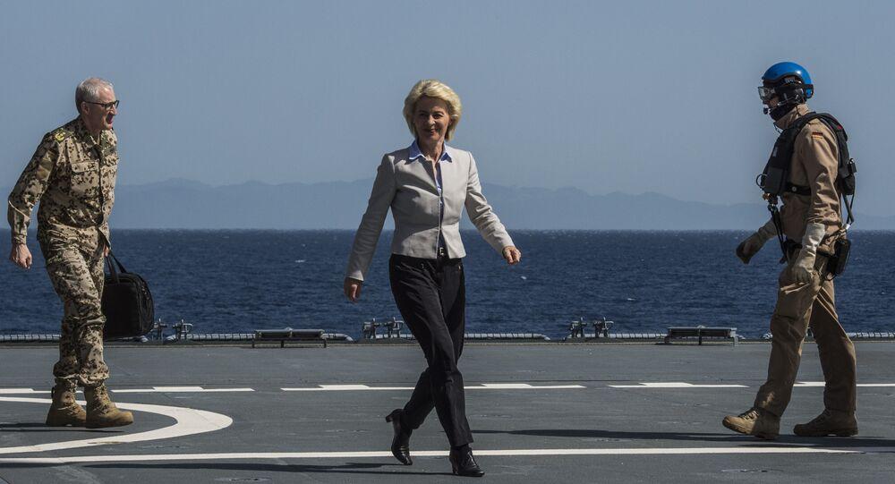 German Defence Minister Ursula von der Leyen walks along the landing pad after landing on the German navy support ship of the German navy support ship Bonn, in the Aegean Sea, off the Turkish coast on April 20, 2016.