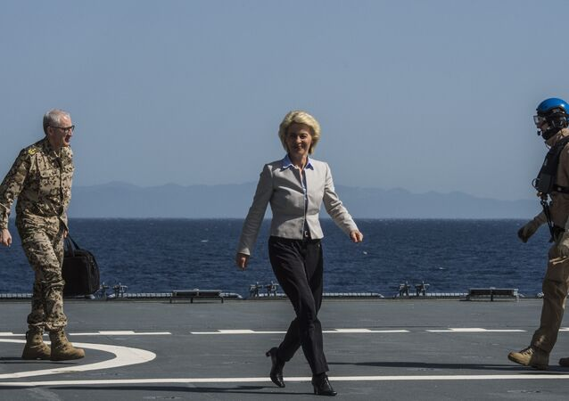 German Defence Minister Ursula von der Leyen walks along the landing pad after landing on the German navy support ship of the German navy support ship Bonn, in the Aegean Sea, off the Turkish coast on April 20, 2016.