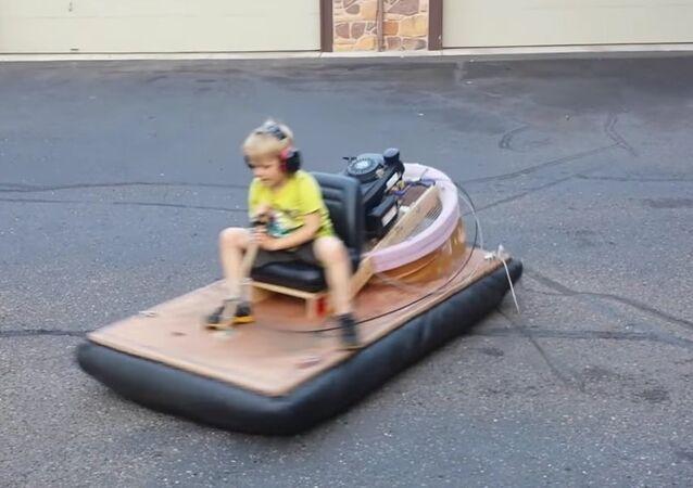 Oliver riding the hovercraft