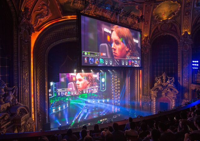 Screens display Ludwig Wåhlberg, player for EG team, during a semifinal match against OG team at the Boston Major Dota 2 tournament at the Wang Theatre in Boston. (File)