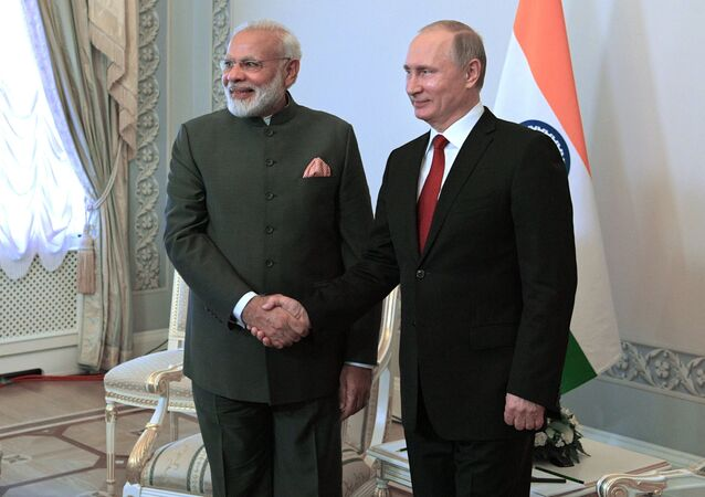 Russian President Vladimir Putin and Indian Prime Minister Narendra Modi, left, during their meeting at St. Petersburg International Economic Forum 2017 in Konstantinovsky Palace in Strelna
