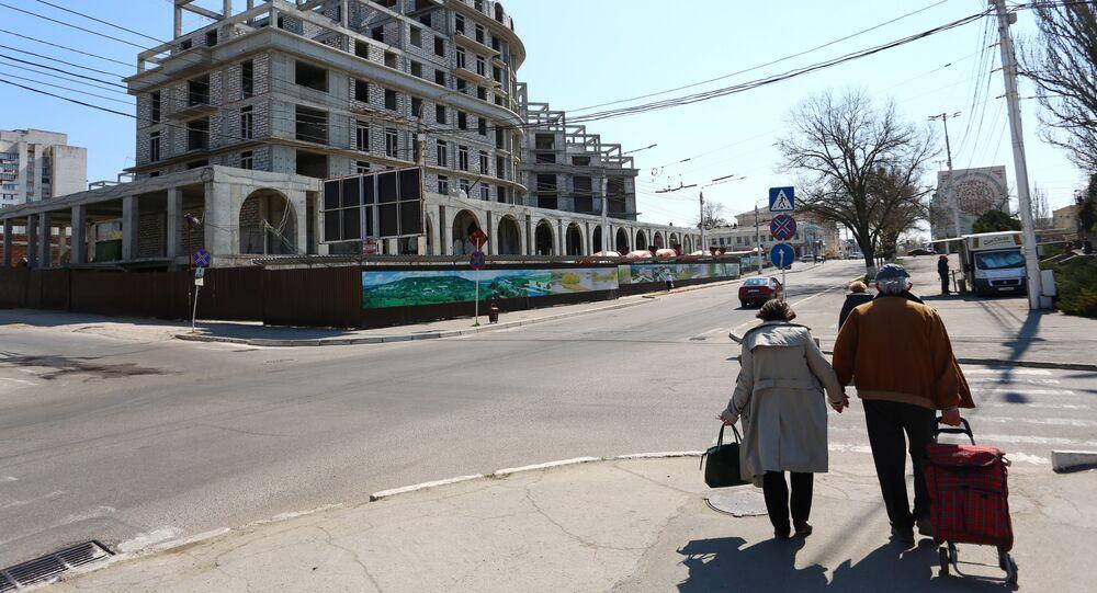 A couple walks in Tiraspol, capital of self-proclaimed Moldovan Republic of Transnistria on April 3, 2017.