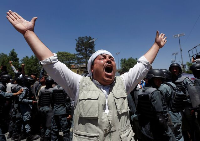 An Afghan man chants slogans, during a protest in Kabul, Afghanistan June 2, 2017.