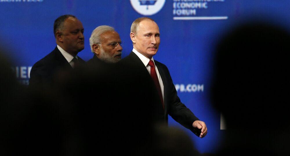 (R-L) Russian President Vladimir Putin, Indian Prime Minister Narendra Modi and Moldovan President Igor Dodon attend a session of the St. Petersburg International Economic Forum (SPIEF), Russia, June 2, 2017.