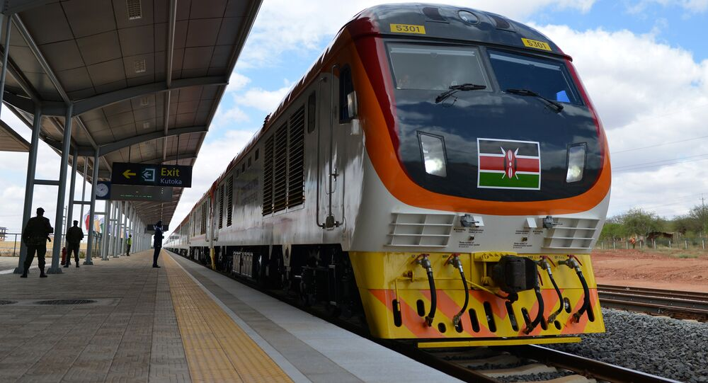 One of Kenya's newly acquired standard gauge rail locomotive, carrying Kenyan President pulls into Voi railway station on May 31, 2017 in Voi, during an inaugural ride on Kenya's new standard gauge railway from the coastal city of Mombasa to the capital, Nairobi.