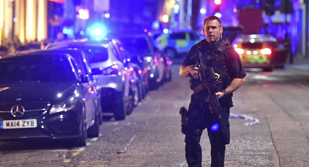 An armed police stands on Borough High Street as police are dealing with an incident on London Bridge in London, Saturday, June 3, 2017.