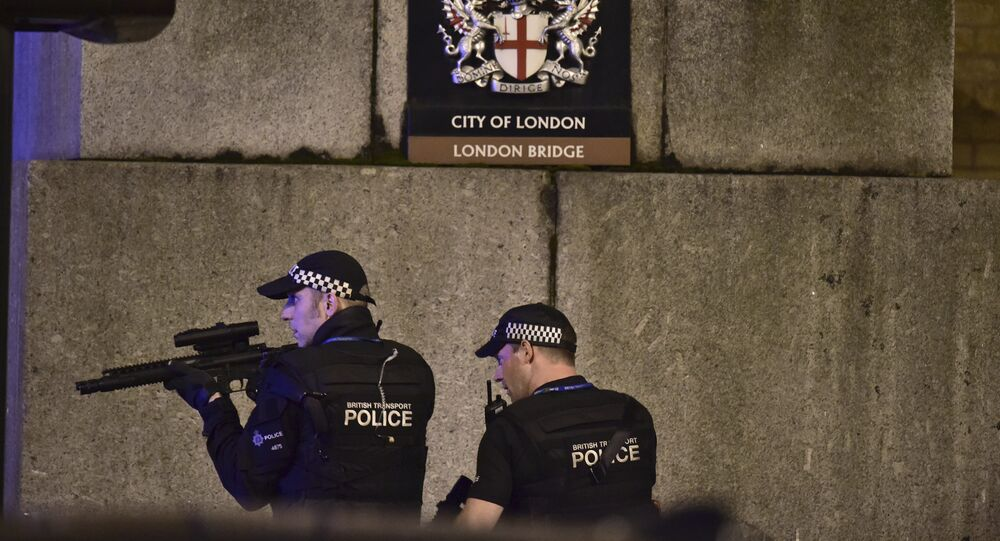 An armed Police officer looks through his weapon on London Bridge in London, Saturday, June 3, 2017.