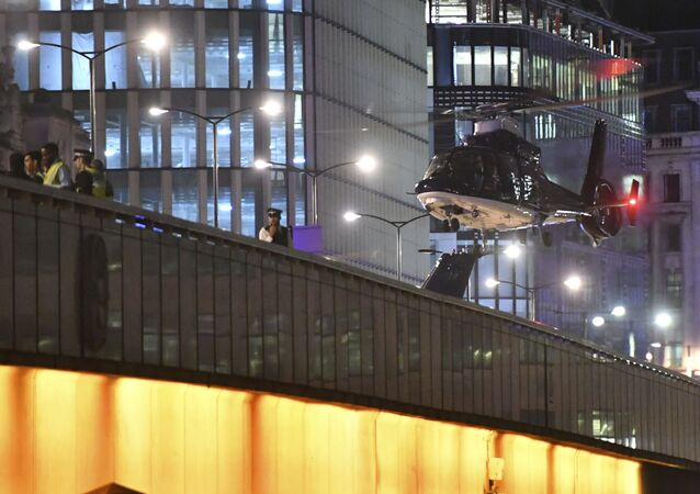An helicopter lands on London Bridge after an attack in central London, Saturday, June 3, 2017.