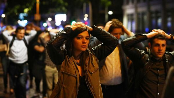 People leave the area with their hands up after an incident near London Bridge in London, Britain June 4, 2017 - Sputnik International