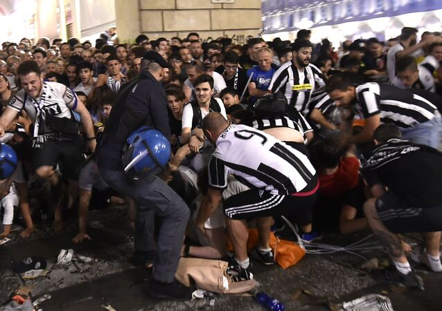 Football Soccer - Juventus v Real Madrid - UEFA Champions League Final - San Carlo Square, Turin, Italy - June 3, 2017 Juventus' fans run away from San Carlo Square following panic created by the explosion of firecrackers as they was watching the match on a giant screen