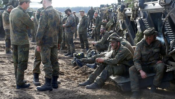 German army soldiers rest after NATO enchanced Forward Presence Battle Group Lithuania exercise in Pabrade military training field, Lithuania, May 17, 2017 - Sputnik International