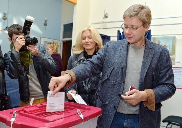 Leader of the pro-Russian Harmony Centre party and Mayor of Riga, Nils Usakovs casts his ballot at a polling station  (File)