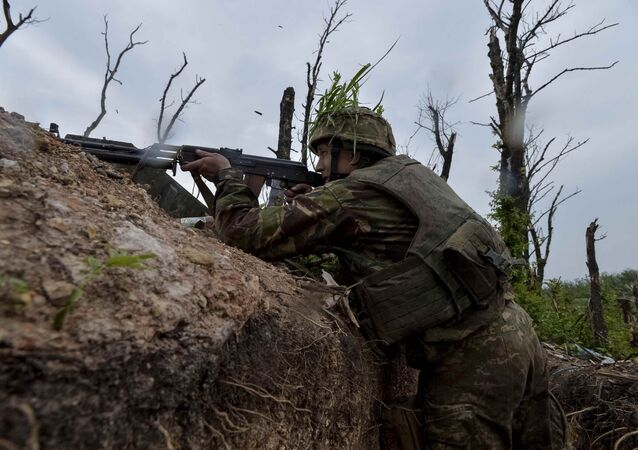 A Ukrainian serviceman fires a machine-gun at his position on the front line at the industrial zone of the government-held town of Avdiyivka, Ukraine, May 22, 2017