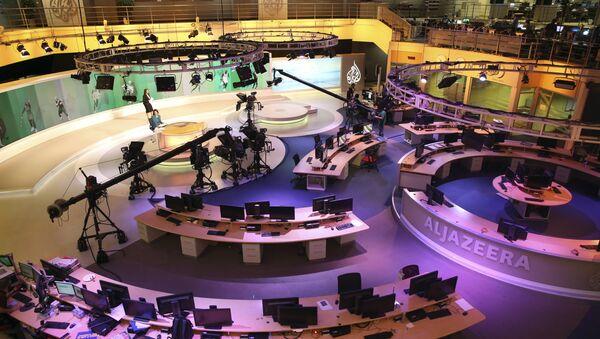 Staff members of Al-Jazeera International work at the news studio in Doha, Qatar (File) - Sputnik International