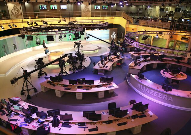 Staff members of Al-Jazeera International work at the news studio in Doha, Qatar (File)