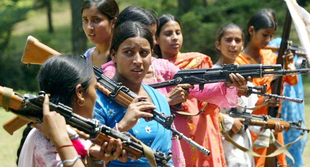 Women Village Defense Committee (VDC) members look on during a training session by the Indian Army at Sariya village, in Naushera sector, about 140 kilometers (88 miles) northwest of Jammu, India (File)