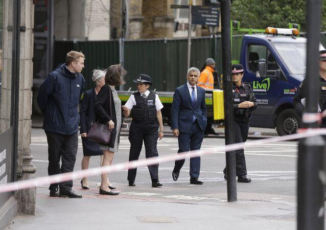 London Police Commissioner Cressida Dick, center left, and the Mayor of London Sadiq Khan, center right, walk near the London Bridge and Borough Market area in London, Monday, June 5, 2017