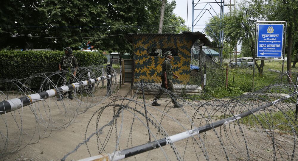 An Indian paramilitary soldier guards at the entarce of his base in Sumbal, 30 kilometers (19 miles) from Srinagar, Indian controlled Kashmir, Monday, June. 5, 2017