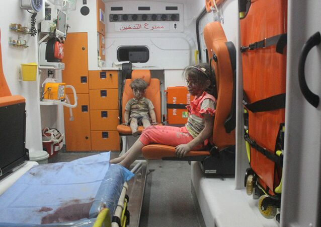 5-year-old Omran Daqneesh and his sister sit in an ambulance after being pulled out of a building hit by an airstrike in Aleppo, Syria, on Aug. 17, 2016
