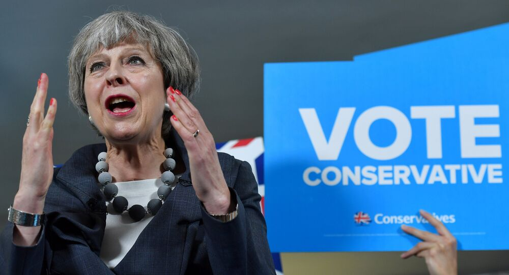 Britain's Prime Minister Theresa May delivers a speech during an election campaign visit to Langton Rugby Club in Stoke-on-Trent, June 6, 2017.