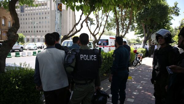 Iranian police stand near the parliament's building during a gunmen attack in central Tehran, Iran, June 7, 2017 - Sputnik International