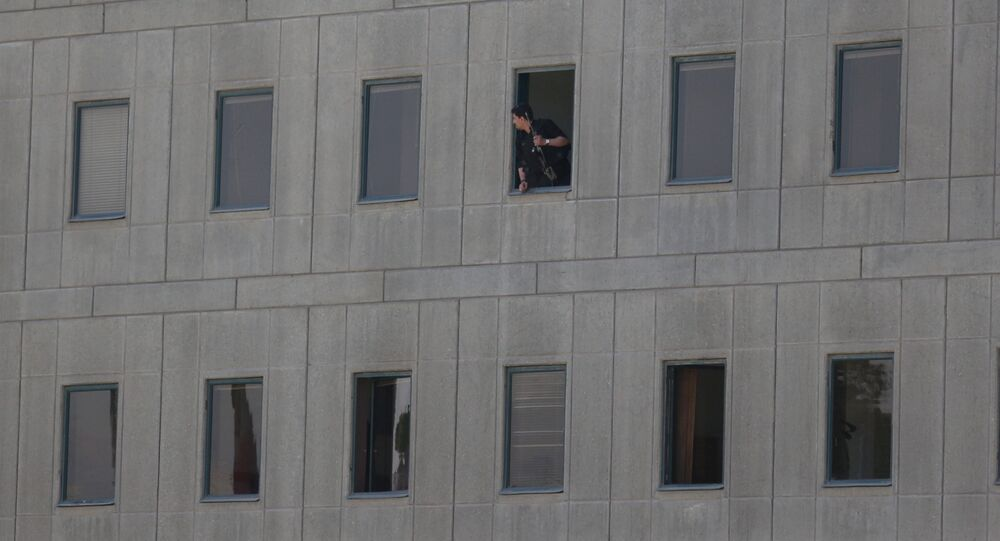An Iranian policeman looks out of the parliament's building in central Tehran, Iran, June 7, 2017