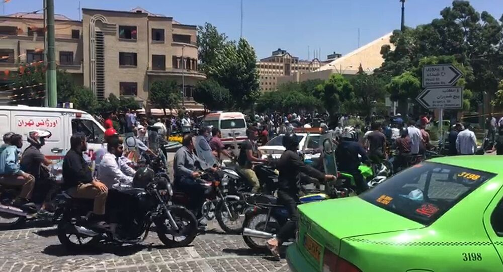 An image grab taken from AFPTV shows the scene outside the mausoleum of Ayatollah Ruhollah Khomeini, the late founder of the Islamic republic, in Tehran's southern suburb of Mossala, during an attack on the complex on June 7, 2017