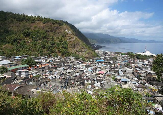 Mutsamudu, the main city of Anjouan Island, Union of the Comoros, is squeezed between the Indian Ocean and steep slopes