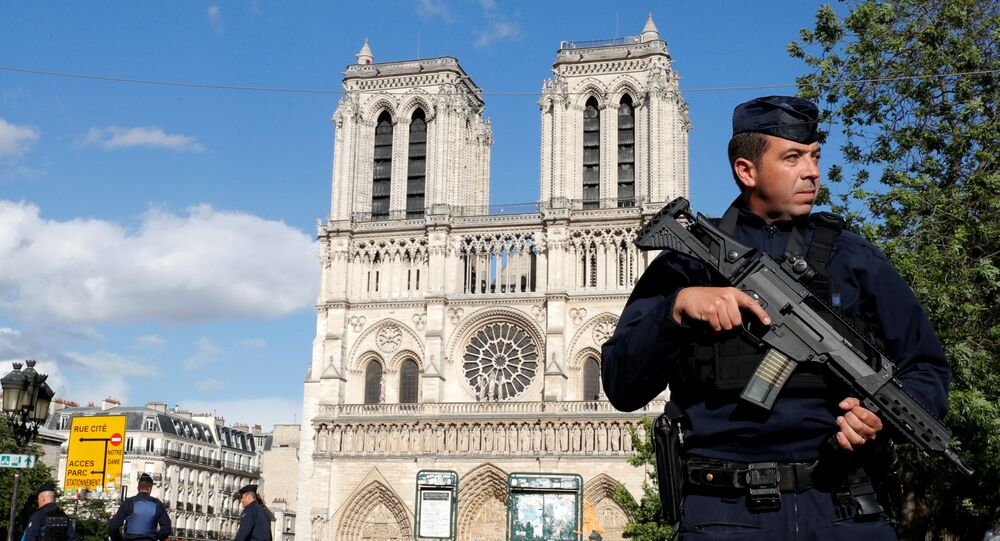 French police and gendarmes stand at the scene of a shooting incident near the Notre Dame Cathedral in Paris, France, June 6, 2017